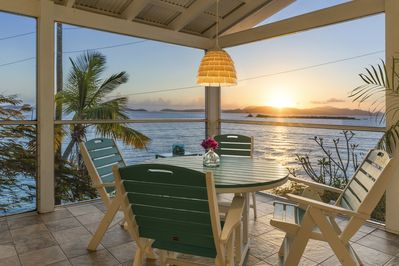 Sunsets: the large 15' x 20' screened in Veranda...with the sounds of the surf.