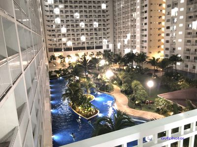 Photo for Hip and Cozy 1 BR w/ Balcony and pool view at Shore Residences MOA