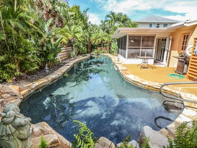 Photo for Welcome to your tropical oasis at 151 Mid Island.  This beautiful, two bedroom, two full bath, ranch home has tropical foliage, an incredibly gorgeous in-ground electric heated pool, and so much more.