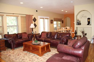 Living Room with plenty of seating for you  Shows old dining room table