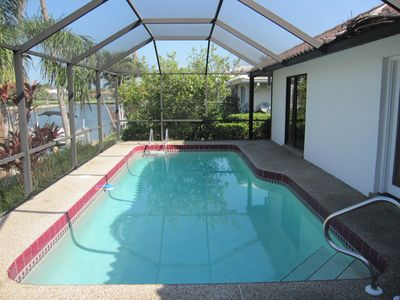 Relax in your own heated pool overlooking the canal with a warm southwestern exp