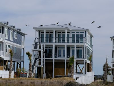 Photo for CUSTOM NEW OAK ISLAND HOME, OCEAN & SOUND FRONT, HEATED POOL/SPA, ELEVATOR, PET