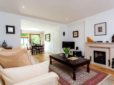 Photo for Bright & cosy 3BR home in chic Kensington, with garden, by Veeve