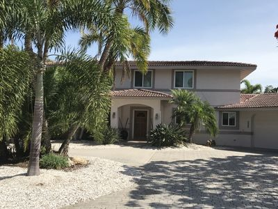 Photo for Nice location on a canal,exclusive interior, pool,close to beach access