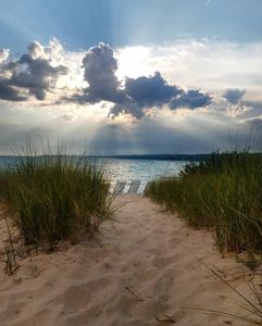 Photo for Charming Harbor Springs cottage right on the sandy beach and crystal water