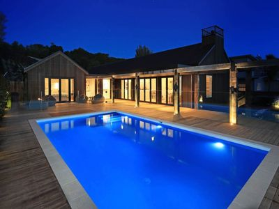 Photo for Stunning modern home with sparkling heated pool