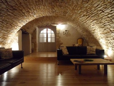 Unique vaulted lounge at night, which has views of the dordogne valley.