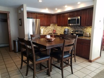 Room A: Kitchen with table seating for 6.