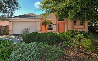 Photo for Bright, cozy vacation home, with large caged pool area, close to Siesta Key
