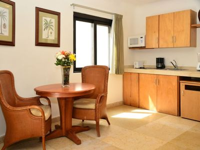 Photo for 2 Suites, Terrace + Pool - Steps to Indigo Beach!
