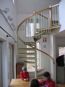 Spiral staircase from dining area to master bedroom