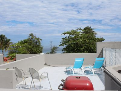 Photo for One bedroom with roof top terrace, one block from the beach