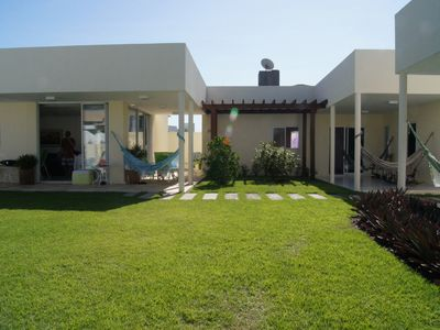 Photo for Beach House in gated community, 5 suites with pool. 400m from the beach
