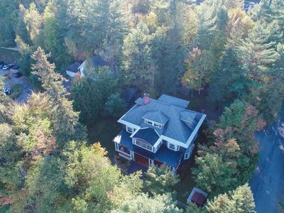 Aerial view during early fall in the village, yet surrounded by trees for privac