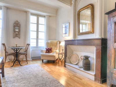 Photo for Charming apartment hidden in the corner of the Place aux Herbes