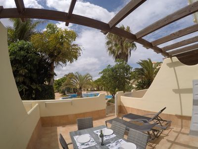 Photo for 3 bedroom villa in quiet complex with swimming pools / private wifi / UKTV