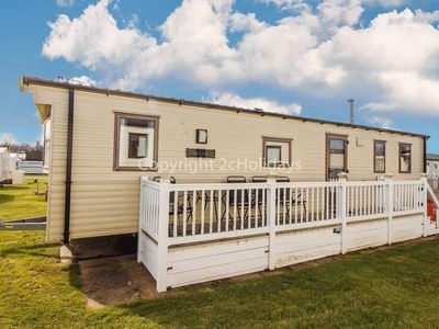Photo for 6 berth caravan for hire at  Haven Hopton village Norfolk with decking ref 80047