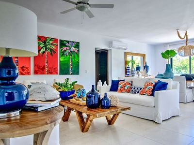 Photo for Cozy 2bd. Apt. with Exquisite Tropical Decor, Pool