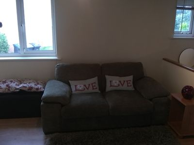 """The living room with comfy pullout sofa bed, ottoman and 32"""" LCD Freeview TV"""
