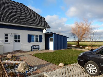 Photo for Exclusive semi-detached house in Altefähr with separate sauna house, 400m to the beach