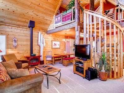 Photo for Unique private log cabin home centrally located, private hot tub, pets friendly