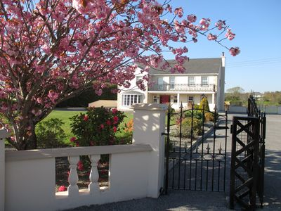 Photo for Luxury 8 BR Home sleeps 14 - 2 Miles from Killarney, free wi-fi/parking. BBQ