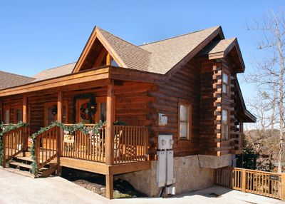 """""""Almost Bearadise"""" Pigeon Forge Cabin Rental - This beautiful 3 level, 2 bedroom, 2 bath log townhome is located just 1 mile from the excitement of Pigeon Forge! With 2 king beds, 1 queen, 2 sleeper sofa/airmattresses and 3 full bathrooms, this home has plenty of room for the whole family."""