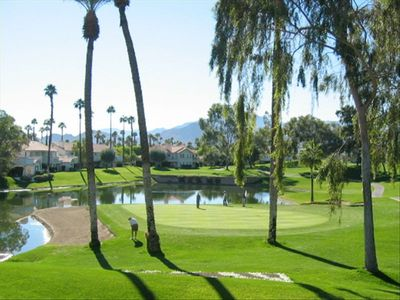 Your Desert Falls Golf Course view out our patio and living room