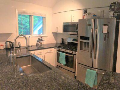 Photo for Luxury 3-bedroom townhouse, sleeps 10, with on-site pool/gym and microbrewery