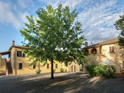 Photo for A small village of five beautiful apartments in the green hills of Tuscany