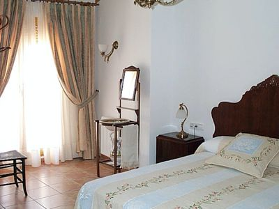 Photo for Family room with twin balcony sleeping four in quality Spanish townhouse  B&B