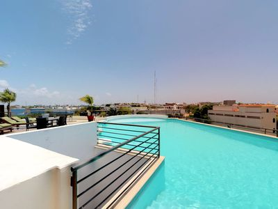 Photo for NEW LISTING! Modern city-view condo w/shared pool, community rooftop deck