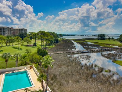 Photo for Luxury condo w/ shared pool & views of the bay & golf course - snowbirds welcome