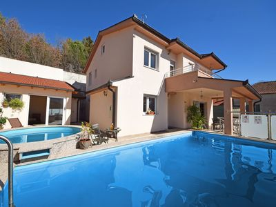Photo for This 4-bedroom villa for up to 8 guests is located in Vrgorac and has a private swimming pool, air-c