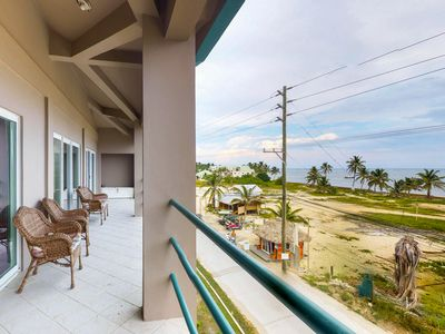 Photo for Waterfront condo with sea views & shared pool - near beaches and restaurants