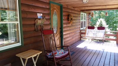 """The front deck with the  Outer Banks rope swing and rocking chairs say, """"Relax!"""""""