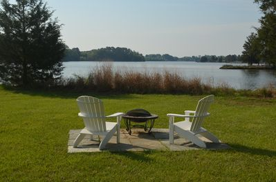 Adirondack chairs with fire pit on flagstone