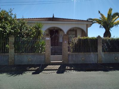 Photo for Villa heated ideal for rest and visit Seville, with swimming pool.