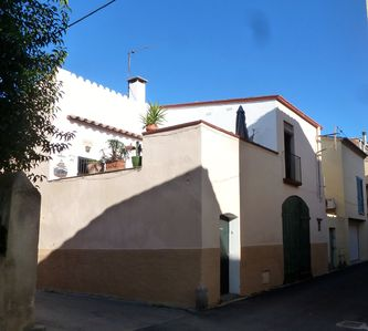 Photo for A typical Catalan tastefully renovated house on the edge of the sea.
