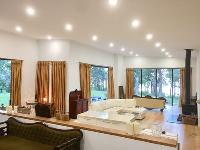O/looking main living area from open plan king suite! Soaring ceiling! S/rises!