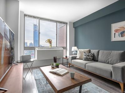 Photo for Mod Midtown West 2BR, Gym, Doorman + Water views by Blueground