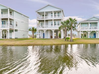 Photo for NEW LISTING! Gulf view home w/deck, pools & hot tub, beach - 2 dogs OK!