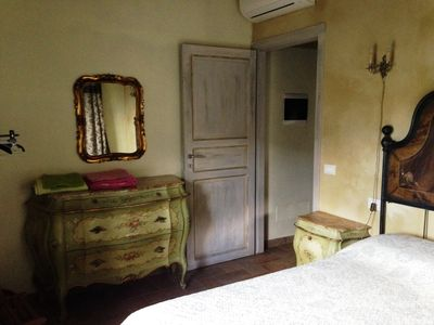 double room with air conditioning and old forniture