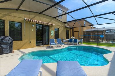South-facing pool deck with comfortable sun loungers
