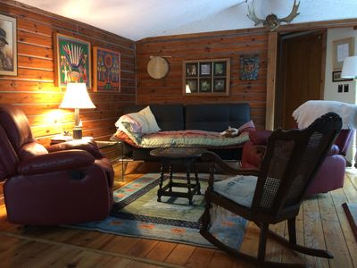Cozy sleeps 8-9 in cabin.  Spacious sleeps up to 13 in camper and artist cabin.