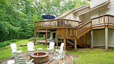 Photo for Lakefront, fire pit, hot tub, free WIFI, mountain views!