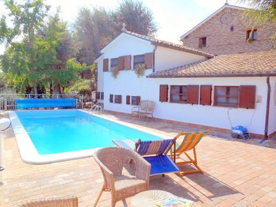Photo for Lovely apartment for 8 people with pool, WIFI, TV, pets allowed and parking