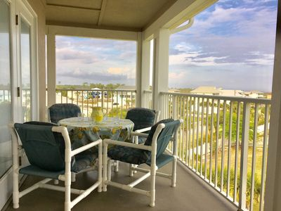 Dine or relax in Gulf breezes on private L-shaped balcony w/ panoramic views