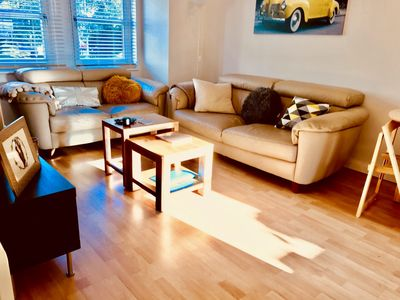 Bright living area with new sofas, dining table, decor, soft furnishings