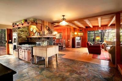 Stunning main living area w/ flagstone kitchen &  clear fir and wide plank floor